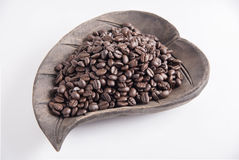 Coffee beans. On wood dish Stock Photos