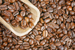 Coffee beans wood scoop Stock Images