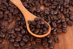Coffee beans and wood spoon Stock Photo