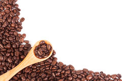 Coffee beans and wood spoon Royalty Free Stock Photography