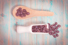 Coffee  beans on wood spoon. Background Royalty Free Stock Photo