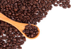 Coffee beans and wood spoon Stock Photography
