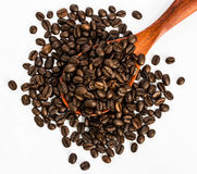 Coffee beans on wood spoon Stock Image
