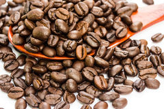 Coffee beans on wood spoon Royalty Free Stock Image