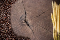 Coffee beans on wood stump Stock Photo
