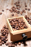 Coffee beans on wood table surface Royalty Free Stock Photo