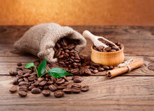 Coffee beans on wood texture Stock Photography