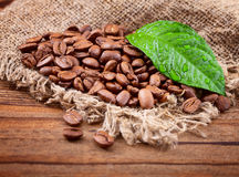 Coffee beans on wood texture Royalty Free Stock Images