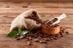 Coffee beans on wood texture Stock Photo