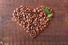 Coffee beans on wood texture Royalty Free Stock Photo