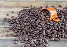 Coffee beans on wooden background Royalty Free Stock Photo