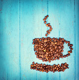 Coffee beans on wooden background Royalty Free Stock Image