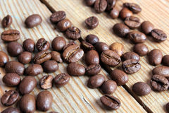 Coffee beans on a wooden background Stock Image