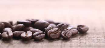 Coffee Beans On Wooden Background. Some coffee beans are on the wooden background stock image