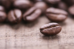 Coffee Beans On Wooden Background. Some coffee beans are on the wooden background stock photo