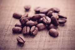 Coffee Beans On Wooden Background. Some coffee beans are on the wooden background stock photography