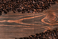 Coffee beans on wooden background Stock Photos