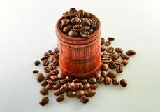 Coffee beans in a wooden barrel isolated on white stock photo