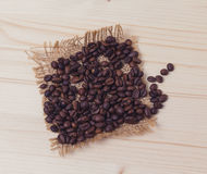 Coffee beans on a wooden board Royalty Free Stock Photography