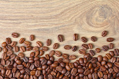 Coffee beans on a wooden board Royalty Free Stock Image