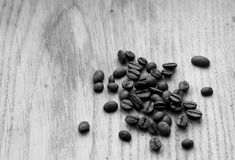 Coffee beans on wooden board with blur effect in black and white. Food and ingredientes Stock Photography