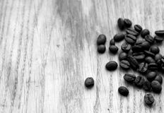 Coffee beans on wooden board with blur effect in black and white. Food and ingredientes Royalty Free Stock Image