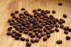 Coffee beans on wooden board with blur effect. Food and ingredientes Royalty Free Stock Image