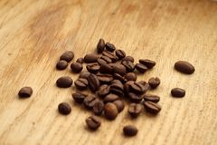 Coffee beans on wooden board with blur effect. Food and ingredientes Stock Photos