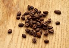 Coffee beans on wooden board with blur effect. Food and ingredientes Stock Images