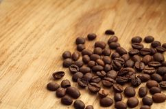 Coffee beans on wooden board with blur effect. Food and ingredientes Royalty Free Stock Images