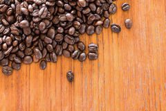 Coffee beans on wooden board. S royalty free stock photos