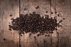 Coffee beans on wooden board Stock Photos