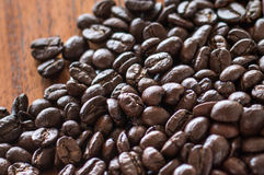 Coffee beans on wooden boards. Coffee beans on wooden board royalty free stock photography