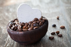 Coffee beans in a wooden bowl Stock Photo