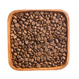 Coffee beans in wooden bowl Stock Photography