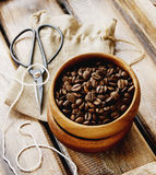 Coffee beans in a wooden bowl with canvas bag Stock Image