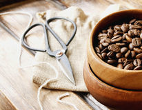 Coffee beans in a wooden bowl with canvas bag Royalty Free Stock Photo