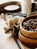Coffee beans in a wooden bowl with canvas bag Stock Photo
