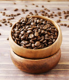 Coffee beans in a wooden bowl Stock Images