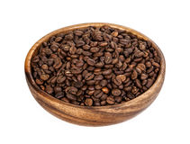 Coffee beans in wooden bowl. Isolated on white background. With clipping path. Stock Images