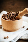 Coffee beans in a wooden bowl Royalty Free Stock Photo