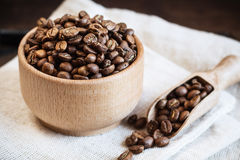 Coffee beans in a wooden bowl Stock Photos