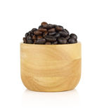 Coffee beans in wooden bowl  on white background Royalty Free Stock Photos