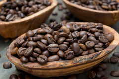 Coffee beans in a wooden bowls, close up Royalty Free Stock Image
