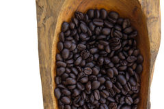 Coffee beans in a wooden bowls, close up, horizontal. Coffee beans in a wooden bowls, close up Stock Photos