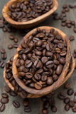 Coffee beans in a wooden bowls, top view Stock Photos