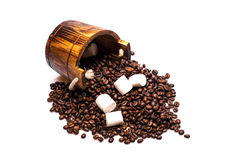 Coffee beans on wooden cask Royalty Free Stock Photo