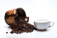 Coffee beans on wooden cask Stock Image