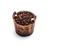 Coffee beans on wooden cask Royalty Free Stock Photos