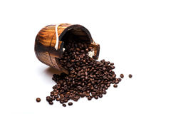 Coffee beans on wooden cask. Coffee beans set up on wooden cask on white background. Side view Royalty Free Stock Photos